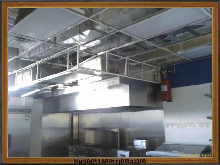 In the left a kitchen in a restaurant showing the acoustical