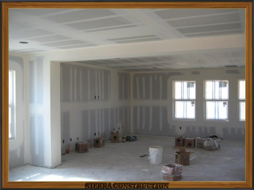 picture showing drywall taping in a big room.