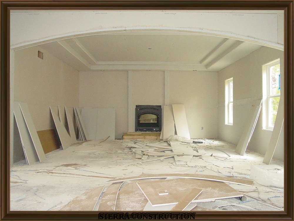picture showing drywall installation in a big room.