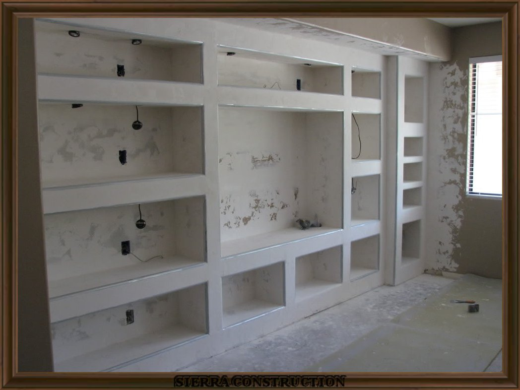 showing a big entertainment center after its been framed, 