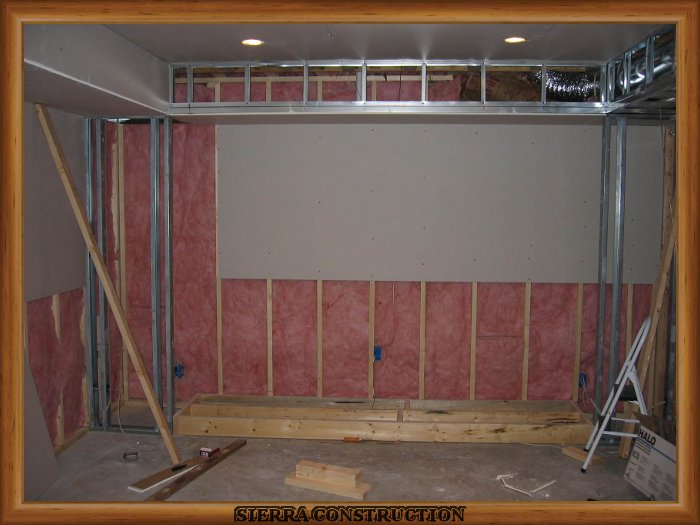 In the left a media room been framed using steel studs