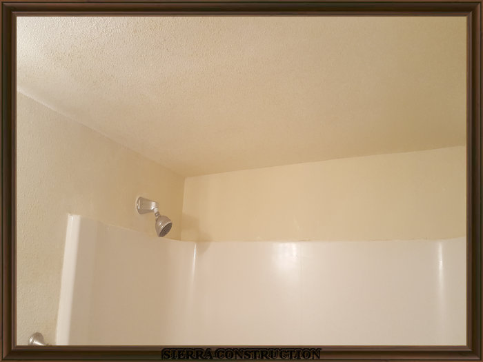A picture in the right showing a bathroom after all the repairs, primer and paint are done looking brand new