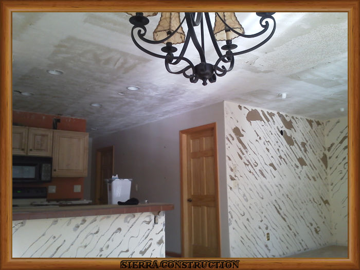 A picture in the left showing a condominium after Popcorn from ceilings and wood from the walls have been removed.