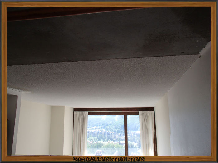 A picture in the left showing a condominium where the popcorn ceiling is been covered