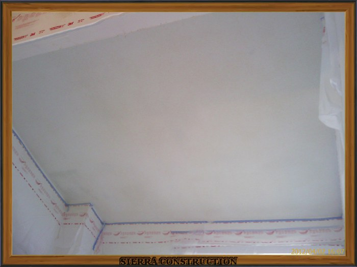 A picture in the right showing a ceiling after the orange peel drywall texture