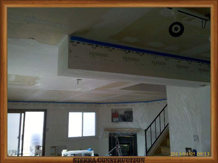 A picture in the left showing a ceiling after the popcorn ceiling have been removed.