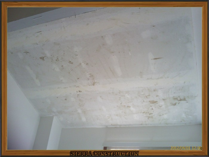 A picture in the left showing a catedral ceiling after the acoustical ceiling