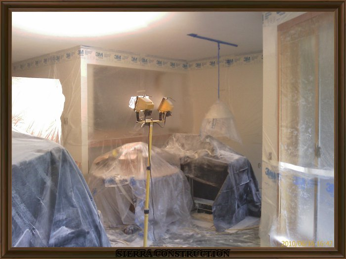 in the right a leaving room covered with plastic ready for
