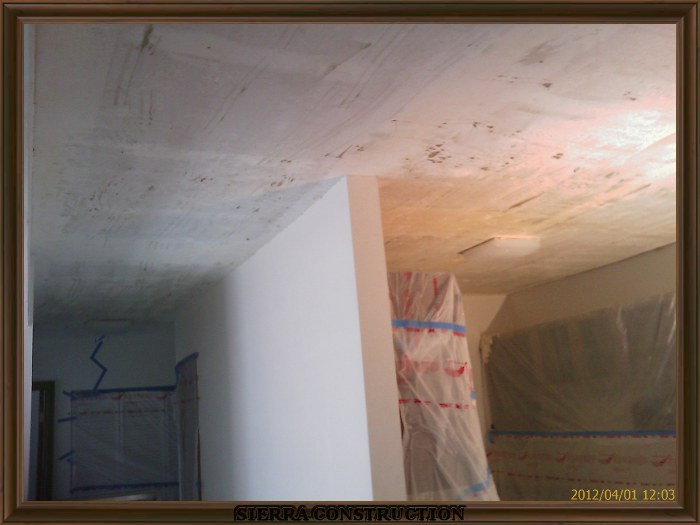 In the left a remodel, a kitchen after the popcorn ceiling removal is done.