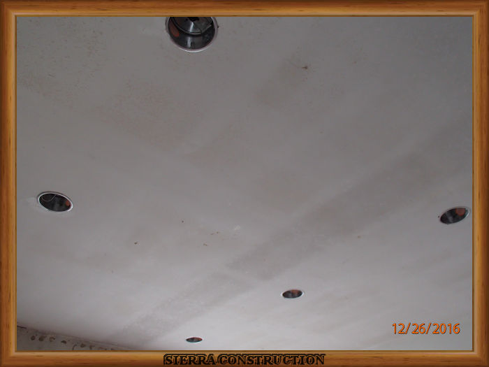 A picture in the left showing a ceiling after the popcorn ceiling have been removed