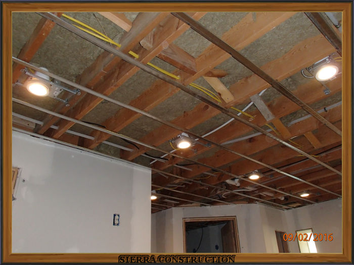A picture in the left showing resilient channel installed in a basement for sound transmission purposes