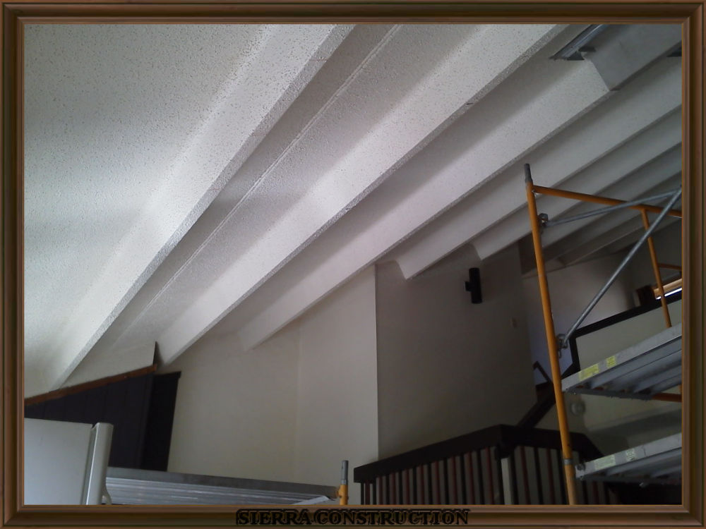 picture showing a concrete ceiling getting ready for steel stud framing.