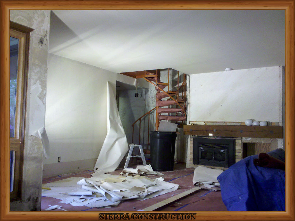 picture showing wallpaper removal being done in a leaving room and bedrooms in a condominium.