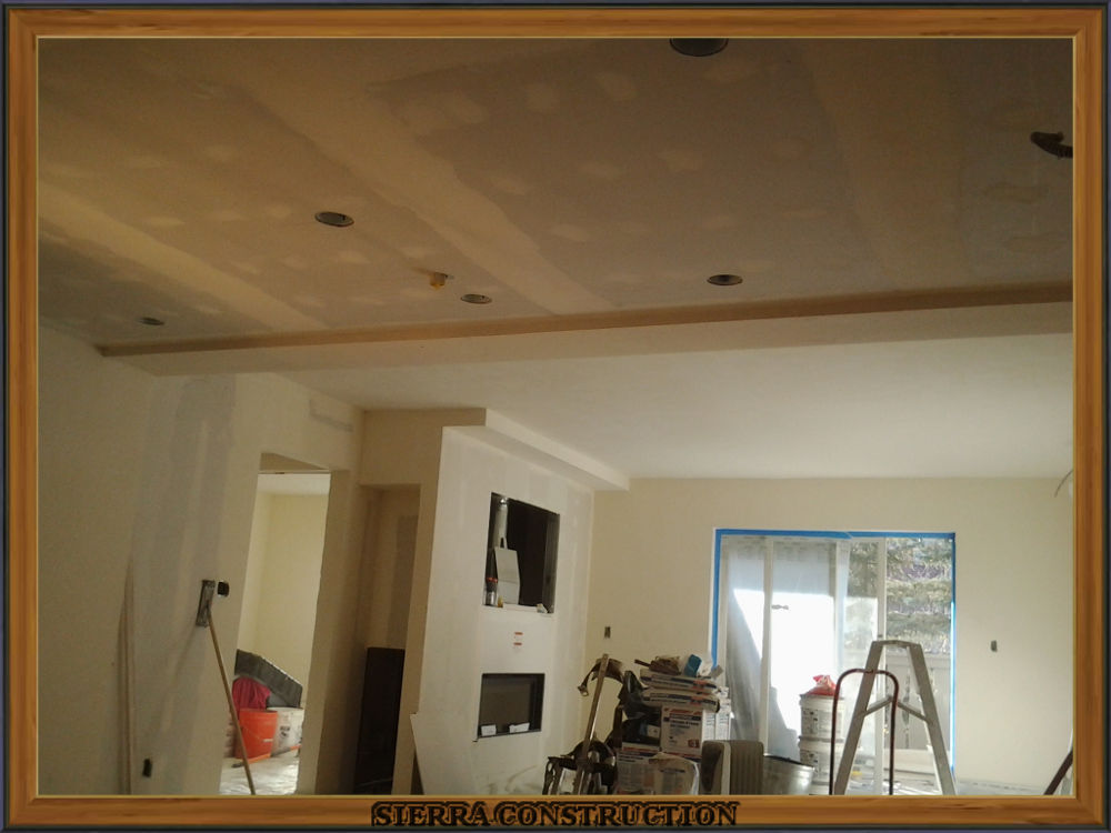 Picture showing the walls and ceiling after the tape have been coated.