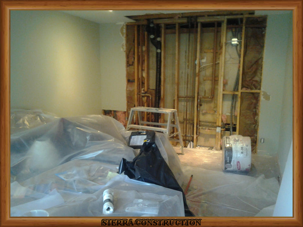 Picture showing the water damage after the wet drywall and insulation are off.