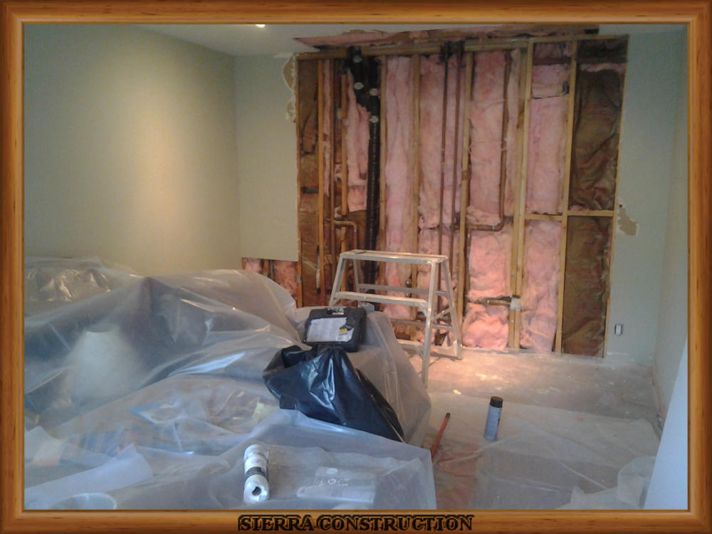 Picture showing the water damage with new insulation.