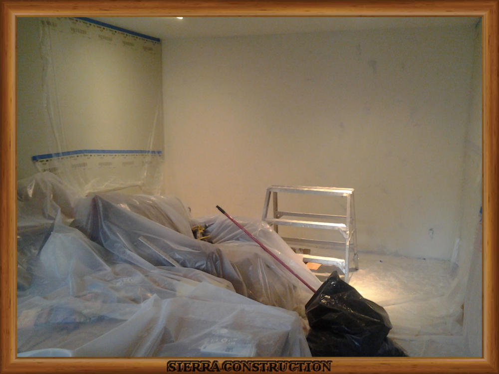 Picture showing the water damage after the drywall have been textured.