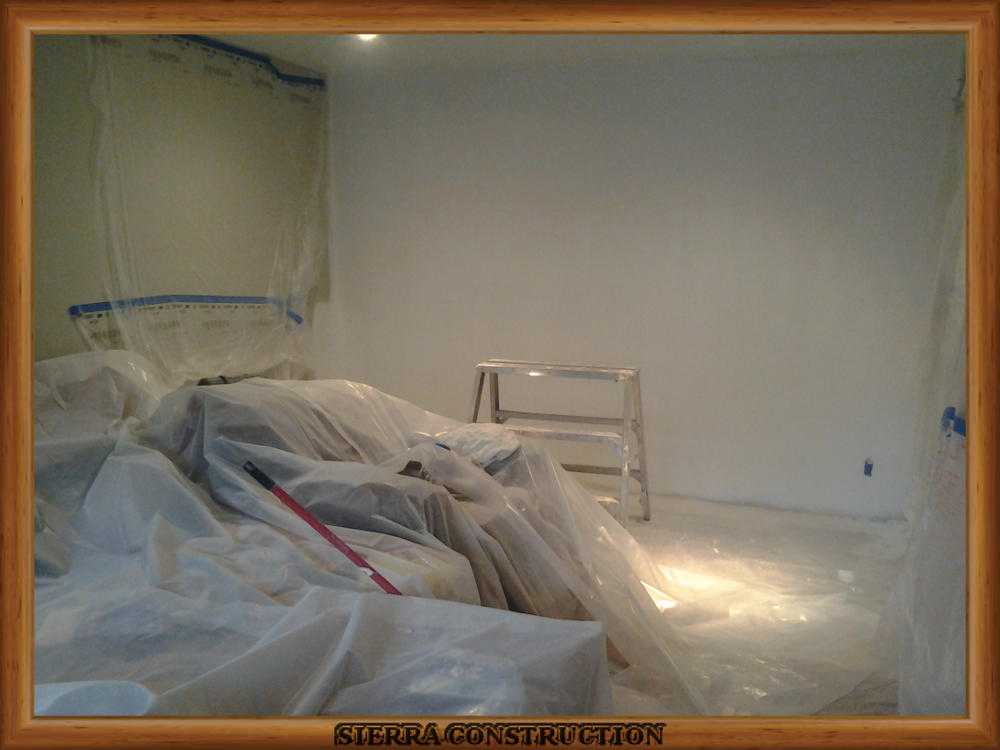 Picture showing the water damage after the wall have been primed.