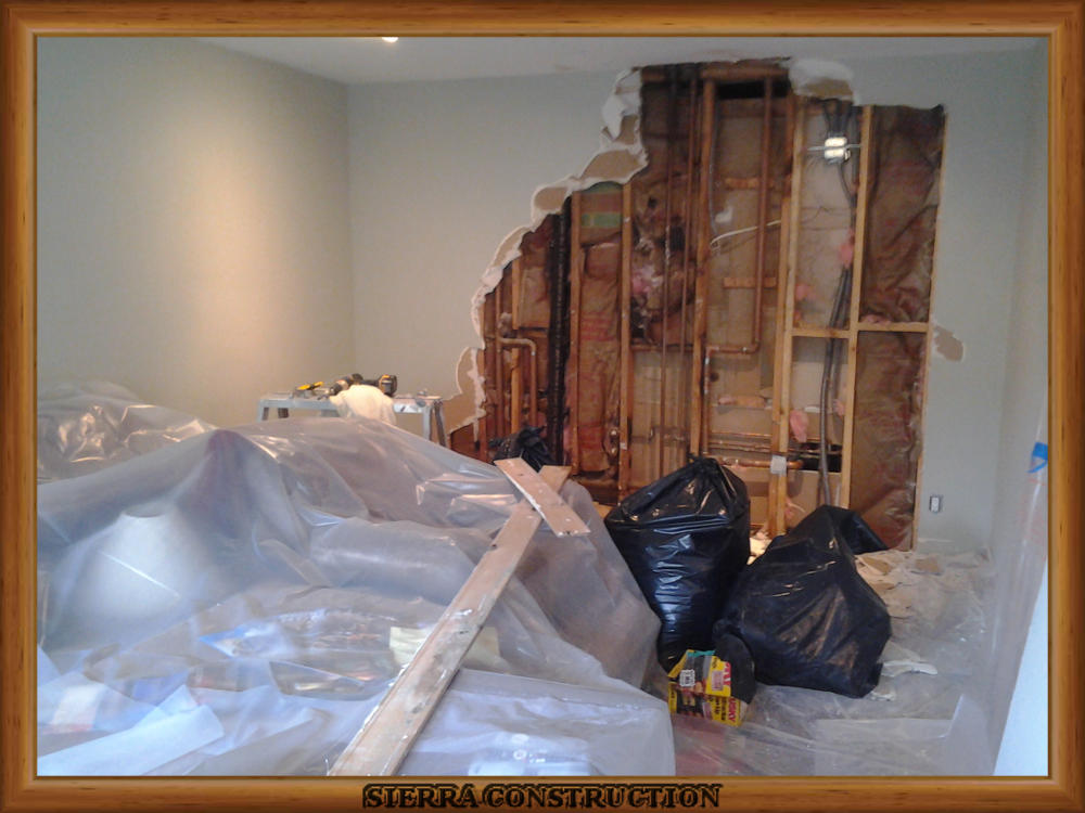 Picture showing water damage in a wall in a condominium